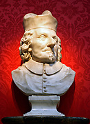 Perhaps by Pierre Legros II (1666-1719) A Cardinal, marble.  The vitality and expressiveness of this bust suggests that it is by the French sculptor Pierre Legros who was working in Rome in the late 1600 and early 1700s. It may have been designed as part of a monument and was perhaps set in a circular frame.