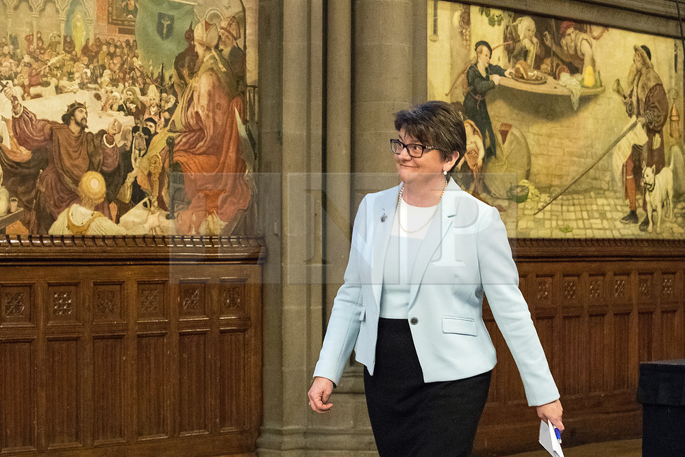© Licensed to London News Pictures  . 03/10/2017 . Manchester , UK . ARLENE FOSTER MLA , leader of the Democratic Unionist Party ( DUP ) in front of Ford Madox Brown's The Trial of Wyclif and The Proclamation Regarding Weights and Measures murals , at a fringe event in the Great Hall in Manchester Town Hall during day three of the Conservative Party Conference at the Manchester Central Convention Centre . Photo credit : Joel Goodman/LNP