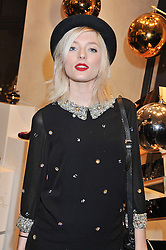 SOPHIE SUMNER at a party to celebrate the launch of a limited edition shoe The Chambord in celebration of Nicholas Kirkwood's partnership with Chambord black raspberry liqueur, held at the Nicholas Kirkwood Boutique, 5 Mount Street, London on 12th December 2012.