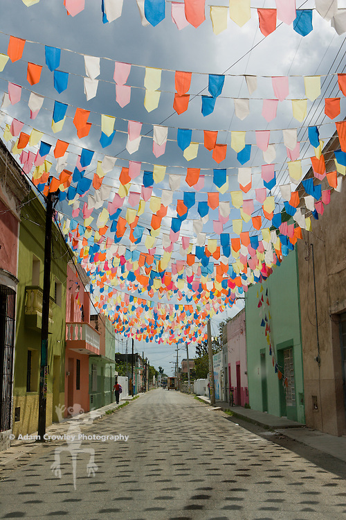 Flags hanging over road in Celestun, Yucatan, Mexico