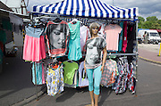 Mannequin wearing a t-shirt covered with full face graphic outside a sidewalk clothing shop. Tomaszow Mazowiecki Central Poland