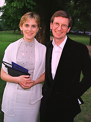 MR DAVID & the HON.MRS MONTGOMERY she is the daughter of Lord Birdwood and previously the Countess of Woolton, at a party in London on 7th July 1999.MUC 105