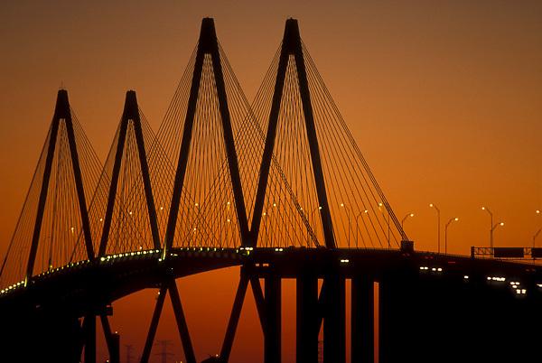 Silhouette of the Fred Hartman Bridge in Galveston Texas at sunset