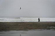 A lone wakeboarder takes a moment to chill on the coast of Outer Sunset, San Francisco, Calif.