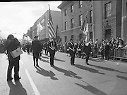 """St Patrick's Day Parade.1982.17/03/1982.03.17.1982.Photo of American """"cops"""" pass the reviewing stand as they march down O'Connell St"""