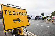 A sign indicating the location of a COVID-19 drive-in testing centre provided by the Department of Health and Social Care and facilitated by Slough Borough Council is pictured on 9 September 2020 in Slough, United Kingdom. The UK government is being criticised since a shortage of COVID-19 testing capacity emerged and will shortly implement tighter restrictions on social gatherings amid mounting concern regarding the possibility of a second coronavirus peak following a significant rise in the rolling seven-day national average of the number of cases reported.