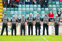 KELOWNA, BC - SEPTEMBER 22:  Game officials stand at attention during the national anthem at the Okanagan Sun against the Valley Huskers at the Apple Bowl on September 22, 2019 in Kelowna, Canada. (Photo by Marissa Baecker/Shoot the Breeze)
