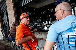 October 7, 2016 - Florida, U.S. - Dave Lynn, left, enjoys beer with his brother-in-law John Samuels at Grimaldi's Pizzeria in Downtown at the Gardens, Friday afternoon after the passing of Hurricane Matthew, October 7, 2016 in Palm Beach Gardens. (Credit Image: © Yuting Jiang/The Palm Beach Post via ZUMA Wire)