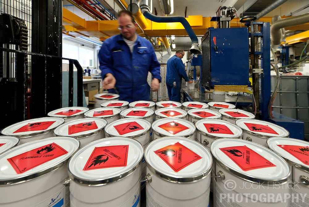 AkzoNobel employees work at the AkzoNobel paint production facility in Sassenheim, the Netherlands, Wednesday, Dec. 22, 2010. Akzo Nobel NV, the world's biggest paint maker, reported a 21 percent increase in third quarter net income to 238 million euros. (Photo © Jock Fistick)