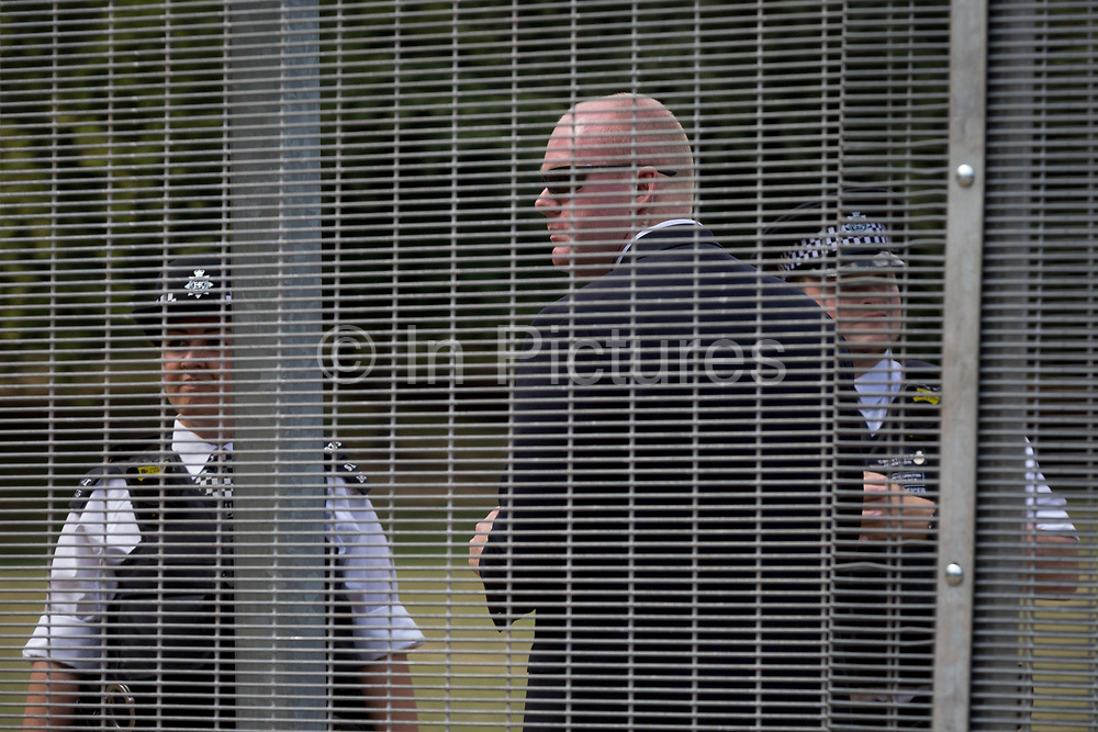 American Secret Service and UK police guard a temporary perimeter fence encircling Winfield House, the official residence of the US Ambassador during the visit to the UK of US President, Donald Trump, on 12th July 2018, in Regents Park, London, England.