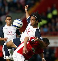 Photo: Chris Ratcliffe.<br />Charlton Athletic v Tottenham Hotspur. The Barclays Premiership. 01/10/2005.<br />Mido climbs all over Radostin Kishishev