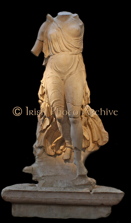Nike of Paionios, from Olympia, c. 425-421.  The winged goddess Nike (Victory) is flying in to land on top of a tall triangular pillar.  At the same time an eagle passes beneath her feet.  The figure was made of Parian marble, by the sculptor Paionios of Mende.  It was found fallen from its base in front of the temple of Zeus.