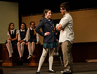"""Summer"" Chelsea Sasserson and ""Dewey Finn"" Jonathan Buttrick on stage for dress rehearsal in School of Rock with Gilford High School on Tuesday evening.  (Karen Bobotas/for the Laconia Daily Sun)"