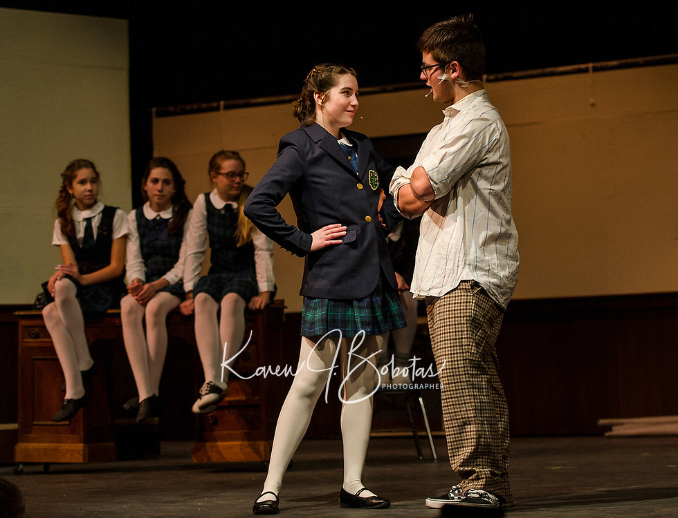 """""""Summer"""" Chelsea Sasserson and """"Dewey Finn"""" Jonathan Buttrick on stage for dress rehearsal in School of Rock with Gilford High School on Tuesday evening.  (Karen Bobotas/for the Laconia Daily Sun)"""