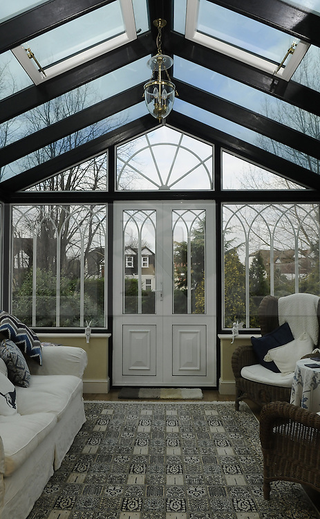 """© Licensed to London News Pictures. 07/01/2012.Conservatory..Bromley couple Graham King and Pamela Rutter have decided to give away their house in a Prize Property Competition. Frustrated after months of being unable to sell the family home because of the current economic climate,  Graham and Partner Pamela from Cromwell Avenue in Bromley have set up a website (www.prizeproperty.co.uk) so that people can view the property and purchase tickets for the competition at £30.00 each, people will have to answer three questions about Bromley to enter. The competition which is due to start this week will run until June 29 2012..Mr King needs to sell 25.000 tickets for the prize draw to go ahead. If fewer than 23,400 tickets are sold a cash prize will be given to the winner instead. Mr King a Business Consultant said """"The biggest challenge will be to sell enough tickets""""..Weather Photo credit : Grant Falvey/LNP"""