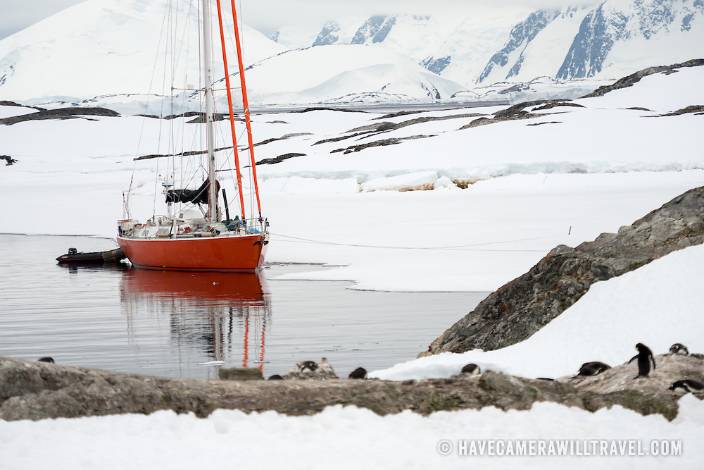 A salboat anchors next to the shore at Galindez Island near the Vernadsky Research Base on the Antarctic Peninsula.