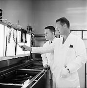 "Y-620907A-12. ""Emanuel. Interns folder. X ray, rehab, lab, heart, exterior rehab, display in lobby. September 7, 1962"