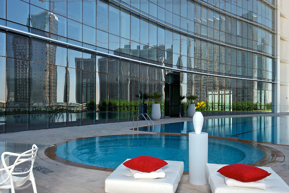 Pool side shot of a new residential building in Abu Dhabi