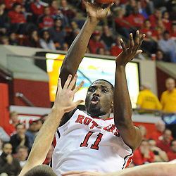 Rutgers Scarlet Knights guard/forward Dane Miller (11) shoots a jumper over Notre Dame Fighting Irish guard/forward Pat Connaughton (24) during Big East NCAA action during Rutgers' 65-58 victory over Notre Dame at the Louis Brown Athletic Center in Piscataway, N.J.
