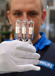 At the lamp finishing station, Philips' techician Nico Bens, makes a visual inspection, which is the first time in the manufacturing process that the ceramic metal halide lamps are touched by human hands, at the Philips Lighting factory, in Turnhout, Belgium, on Friday, Oct. 15, 2010. (Photo © Jock Fistick)