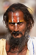 Hindu Sadhu holy man with traditional markings in street in Nandi near Varanasi, Benares, Northern India