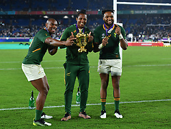 South Africa's Sbu Nkosi with Makazole Mapimpi and Lukhanyo Am after the 2019 Rugby World Cup final match at Yokohama Stadium.