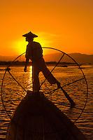 Legrowing fisherman on Inle Lake at sunset, Inle Lake, Shan State, Myanmar (Burma)