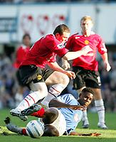 Fotball<br /> Premier League England 2004/2005<br /> Foto: SBI/Digitalsport<br /> NORWAY ONLY<br /> <br /> 30.10.2004<br /> Portsmouth v Manchester United<br /> <br /> Manchester's Wayne Roone is tackled by Portsmouth's Dejan Stefanovic