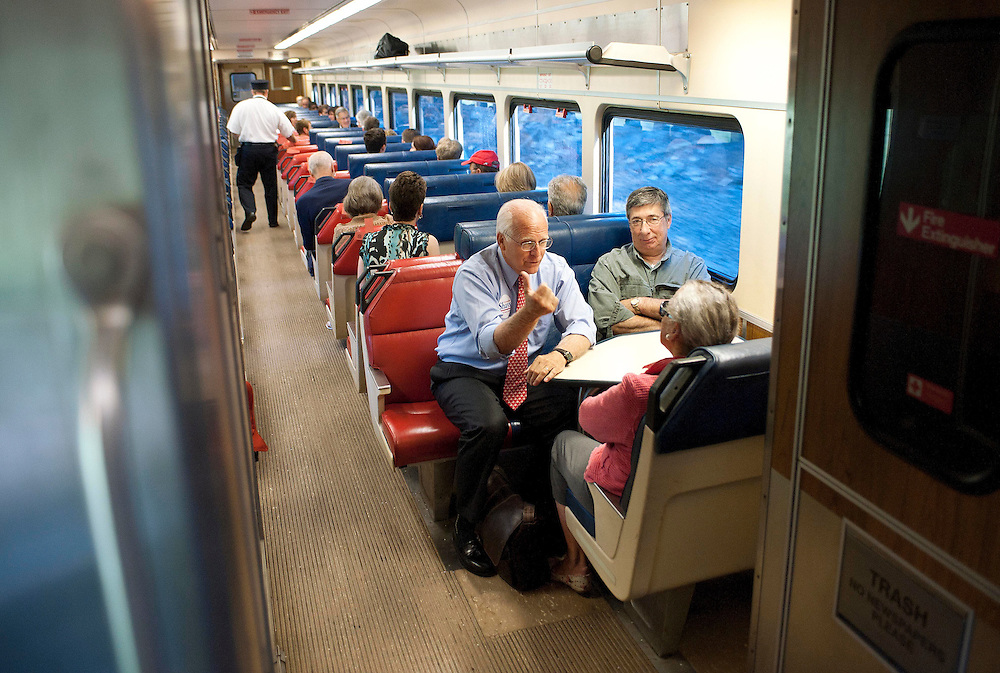 Republican candidate for U.S. Senate Chris Shays, front, left, and wife Betsi, talk with passenger Lou Forte, front right, of Guilford on a train in Madison, Conn., Wednesday, July 25, 2012. (AP Photo/Jessica Hill)