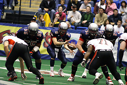14 April 2007: Steve LaFalce takes the long snap from Luke Wickman during a United Indoor Football League game that pitted the RiverCity Rage who won 29-11 against the Bloomington Extreme at the U.S. Cellular Coliseum in Bloomington Illinois..