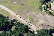 Nederland, Noord-Brabant, Hilvarenbeek, 23-08-2016; Safaripark Beekse Bergen, dierenpark. File van atou's omgeven door giraffen.<br /> Safari park Beekse Bergen, zoo.<br /> aerial photo (additional fee required); <br /> luchtfoto (toeslag op standard tarieven);<br /> copyright foto/photo Siebe Swart