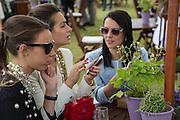 MELISSA MILLS; SASKIA BOXFORD; JULIET ANGUS, Cartier Queen's Cup final at Guards Polo Club, Windsor Great Park. 16 June 2013