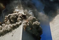 Sept. 11, 2001 - New York, New York, U.S. - The south tower of the World Trade Center, left, begins to collapse in New York Tuesday Sept. 11. 2001. In the most horrifying attacks ever against the U.S., terrorists crashed two airliners into the World Trade center in a deadly series of blows that brought down the twin 110-story towers. (Credit Image: © Gulnara Samoilova/ZUMA Wire/ZUMAPRESS.com)