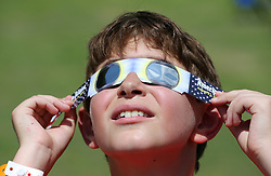 Alex Levingston, Sandy Springs, trys out his pair of eclipse glasses to look at the sun from Snyer Field during a solar eclipse shabbat at Ramah Darom on Monday, August 21, 2017, in Clayton, a city in the path of totality in North Georgia. Photo by Curtis Compton/Atlanta Journal-Constitution/TNS/ABACAPRESS.COM