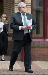 """© Licensed to London News Pictures. 03/06/2016. Woking, UK.Des James leaves Woking Coroner's Court. A second inquest into the death of army recruit Private Cheryl James has announced its verdict today. Coroner Brian Barker QC has ruled the death of Private James was caused by a """"self-inflicted"""" wound. Cheryl was found dead with a bullet wound to her head in November 1995.  Aged just 18 she was one of four young soldiers who died at the Deepcut Barracks in Surrey between 1995 and 2002, amid claims of bullying and abuse. Photo credit: Peter Macdiarmid/LNP"""