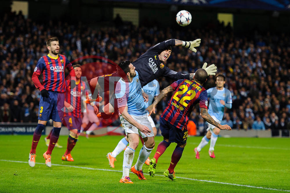 Barcelona Goalkeeper Victor Valdes (ESP) dives to block the ball from Man City Forward Alvaro Negredo (ESP) - Photo mandatory by-line: Rogan Thomson/JMP - Tel: 07966 386802 - 18/02/2014 - SPORT - FOOTBALL - Etihad Stadium, Manchester - Manchester City v Barcelona - UEFA Champions League, Round of 16, First leg.