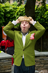 Pictured: Bruno tried on a wig before he tried the hats.<br /> Pupils from Royal Mile Primary tried  on crazy hats made by a performer from company Mischief Labas, which is holding a hat-making workshop at the Imaginate opening weekend on May 28-29<br /> <br /> <br /> <br /> Ger Harley | EEm 26 May 2016