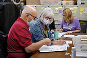 09 NOVEMBER 2020 - NEWTON, IOWA: STEVE MULLAN and KATHY SEXTON, members of the 10 person audit board, recount ballots by hand in Jasper County. The Jasper County (Iowa) auditor ordered a manual recount of 561 votes from Clear Creek Poweshiek precinct in Mingo after vote totals were incorrectly transcribed on a spreadsheet. The incorrect vote total tabulation could affect the outcome of the election for Iowa's second congressional district. The incorrect transcription awarded more votes to Republican Congressional candidate Mariannette Miller-Meeks than she actually won and changed the outcome of the race. The corrected totals changed 162 votes and put Rita Hart, the Democratic candidate in the lead by 282 votes. The race is one of the closest races for a Congressional seat.      PHOTO BY JACK KURTZ