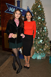 Left to right, MADDIE MILLS and her mother YASMIN MILLS at the official opening of the 2014 Tiffany & Co.Christmas Shop on Bond Street, London on 16th November 2014.