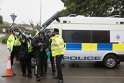 Hertfordshire Police officers invoke Section 14 of the Public Order Act 1986 to clear a press photographer from an area outside an entrance to the Chiltern Tunnel South Portal site for the HS2 high-speed rail link for the entire day on 9 October 2020 in West Hyde, United Kingdom. The protest action by anti-HS2 activists, at the site from which HS2 Ltd intends to drill a 10-mile tunnel through the Chilterns, was intended to remind Prime Minister Boris Johnson that he committed to remove deforestation from supply chains and to provide legal protection for 30% of UK land for biodiversity by 2030 at the first UN Summit on Biodiversity on 30th September.