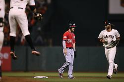 Bryce Harper walks off field as Giants celebrate winning NLDS, 2014 World Series Champion Giants