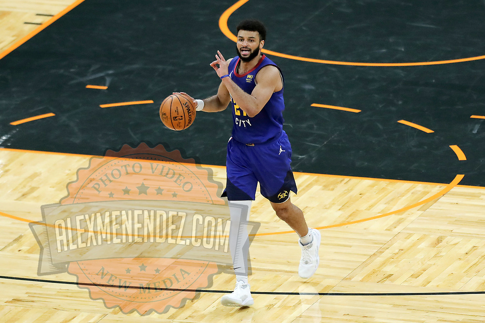 ORLANDO, FL - MARCH 23:  Jamal Murray #27 of the Denver Nuggets controls the ball against the Orlando Magic at Amway Center on March 23, 2021 in Orlando, Florida. NOTE TO USER: User expressly acknowledges and agrees that, by downloading and or using this photograph, User is consenting to the terms and conditions of the Getty Images License Agreement. (Photo by Alex Menendez/Getty Images)*** Local Caption ***  Jamal Murray