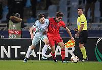SAN SEBASTIAN, SPAIN - DECEMBER 07, 2017. 2017-18 UEFA Europa League Group L Round 6 football match: Real Sociedad (San Sebastian) - Zenit (St Petersburg) 1 - 3. Zenit St Petersburg's Daler Kuzyaev (L) and Real Sociedad's Alvaro Odriozola Arzallus (R).