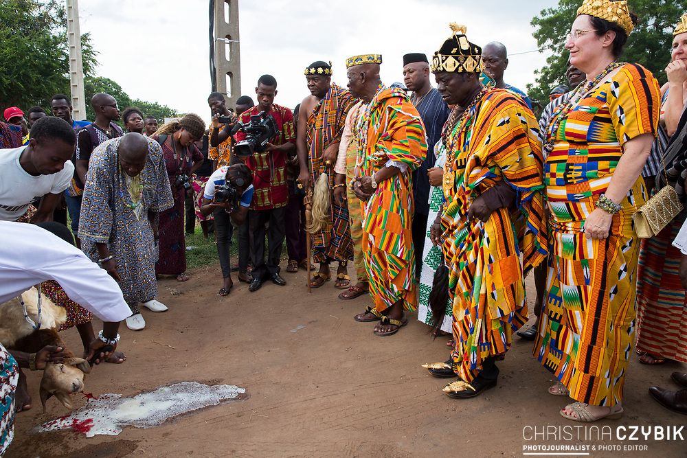 King Cephas Bansah, Queen Gabriele Bansah and Dr. Susi Dattenberg-Doyle (Queen Mother of Gbi Kpoeta Ghana) along with Ewefiaga Togbui Agboli K.F.Agokoli IV (King of the Ewe) visiting the opening ceremony of a traditional market and watch the immolation of a goat<br /> <br /> Day 2 of the Agbogboza Festival in Notse, Togo on September 2nd, 2016<br /> <br /> ***Togbe Ngoryifia Cephas Kosi Bansah of Gbi Traditional Area Hohoe Ghana and Traditional, Spiritual and Honorable King of the Ewes and his wife, Queen Mother Gabriele Akosua Bansah Ahado Hohoe Ghana***