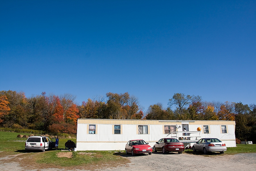 The home of Alfonzo Romero, a long-time employee who lives with his family at Hudson Valley Foie Gras in Ferndale, New York on October 11, 2008. The company provides free housing to some of its employees, particularly to those who work shifts around the clock force-feeding the ducks. Romero, originally from Puebla, came to the United States walking across the border, arriving in Ferndale to become one of the original four employees who started building the factory farm in 1989. His family has since joined him, the factory now employs about 120 workers (many from Puebla) and thus a small, isolated Mexican community flourishes in the Catskills.