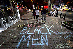 Protesters have used chalk to write slogans and messages on the pavement near the Omni HotelSaturday, September 24, 2016 in Charlotte, NC, USA. Protesters came together for the fifth straight night to protest following the fatal shooting of Keith Lamont Scott. Keith Lamont Scott was shot and killed by Charlotte-Mecklenburg Police Officer Brentley Vinson on Tuesday afternoon. Photo by Jeff Siner/Charlotte Observer/TNS/ABACAPRESS.COM