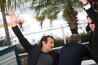 Actor Albert Dupontel, Actor Benoît Poelvoorde, Director Benoît Delepine dismantle the podium at Le Grand Soir photocall at the 65th Cannes Film Festival France. Tuesday 22nd May 2012 in Cannes Film Festival, France.