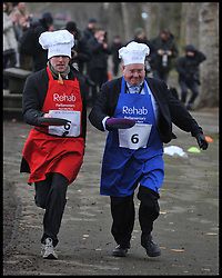 Total Politics editor Ben Duckworth (left) and Lord Rennard take part in the MP's and Lords race against political Journalist in the Rehab Parliamentary Pancake Shrove Tuesday race a charity event which sees MPs and Lords joined by media types in a race to the finish. Victoria Tower Gardens, Westminster, Tuesday February 12, 2013. Photo By Andrew Parsons / i-Images<br /> File photo - Lord Rennard Suspended.<br /> Lib Dems suspend Lord Rennard for refusing to apologise for sex harassment claims minutes before he took seat in Lords.<br /> Photo filed Monda 20th January 2014.