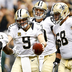 Sep 22, 2013; New Orleans, LA, USA; New Orleans Saints quarterback Drew Brees (9) celebrates with teammates after a touchdown against the Arizona Cardinals during the second half of a game at Mercedes-Benz Superdome. The Saints defeated the Cardinals 31-7. Mandatory Credit: Derick E. Hingle-USA TODAY Sports