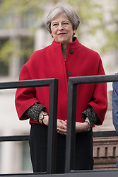 © Licensed to London News Pictures. 24/04/2018. London, UK. © Licensed to London News Pictures. 24/04/2018. London, UK. British Prime Minister THERESA MAY attends the statue unveiling of the Suffragist leader Millicent Fawcett in Parliament Square. The Mayor of London commissioned Turner prize-winning artist GILLIAN WEARING OBE to create the statue. Photo credit: Ray Tang/LNP